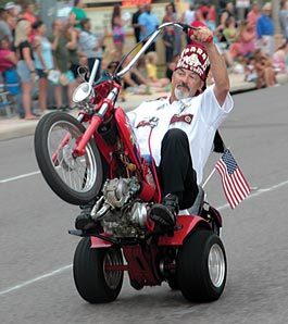 Shriner driving tiny motorcycle