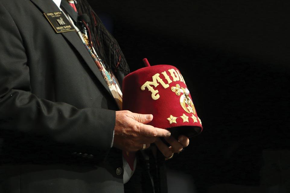 Shriner holding fez