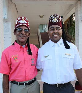two shriners stand together as brothers